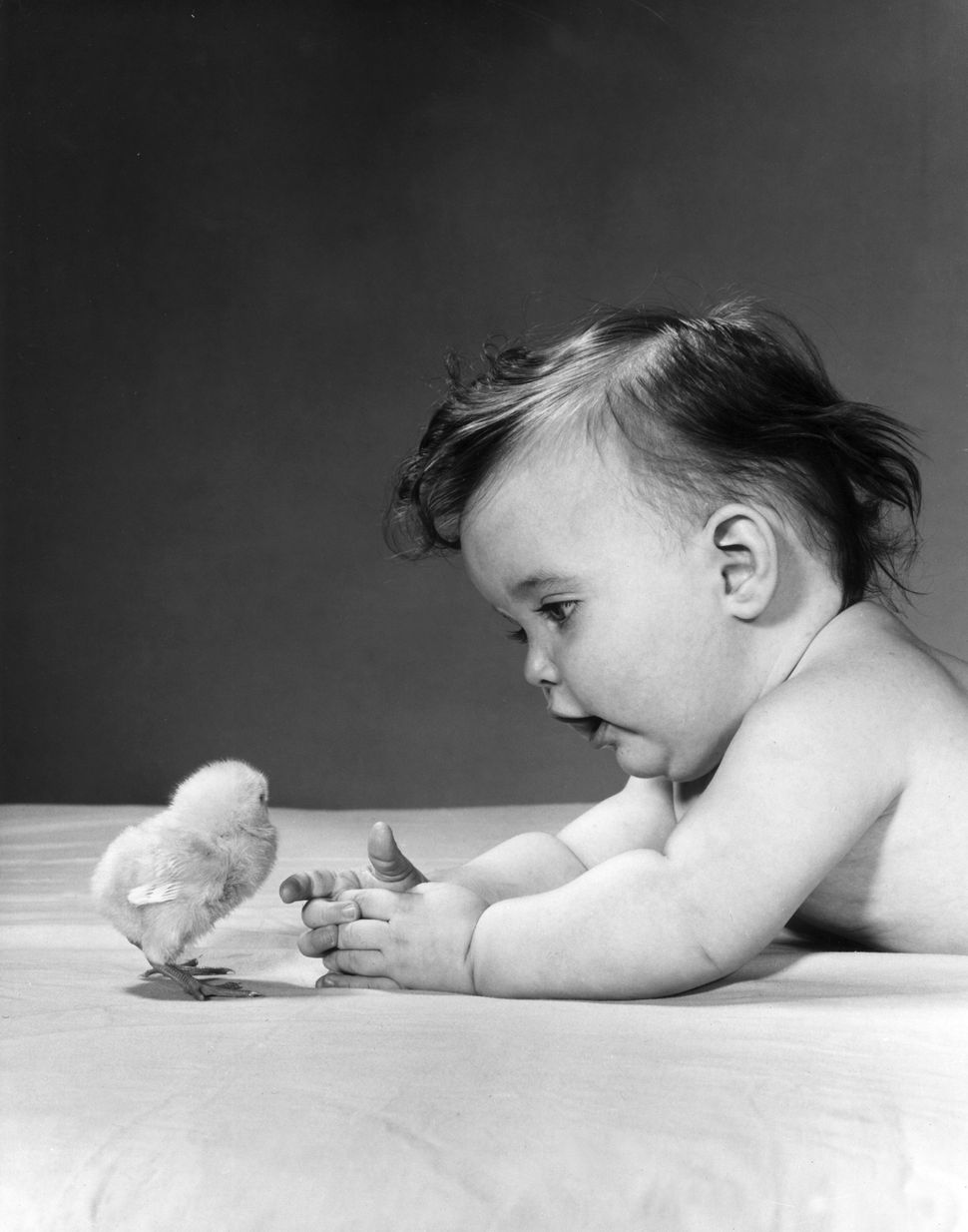 Baby and baby chick, in the 1950s.