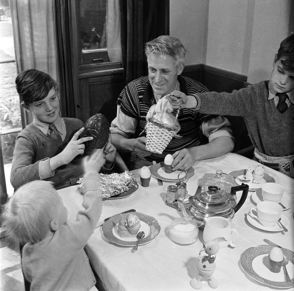 The traditional exchange of chocolate eggs at Easter breakfast in 1955.