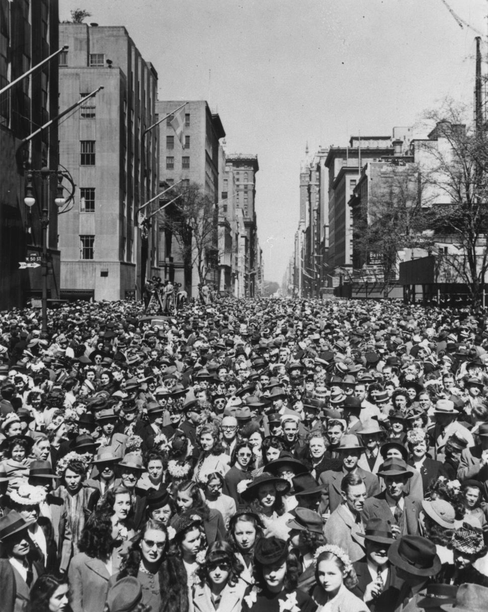 Crowds pack Fifth Avenue in New York City in 1956 to watch the Easter Parade.