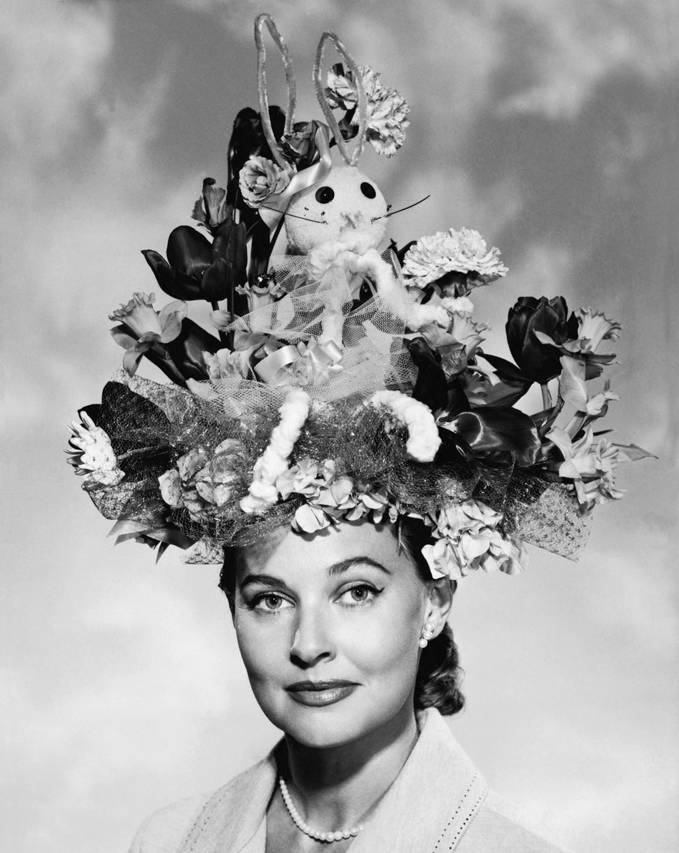 Woman posing with her Easter bonnet.