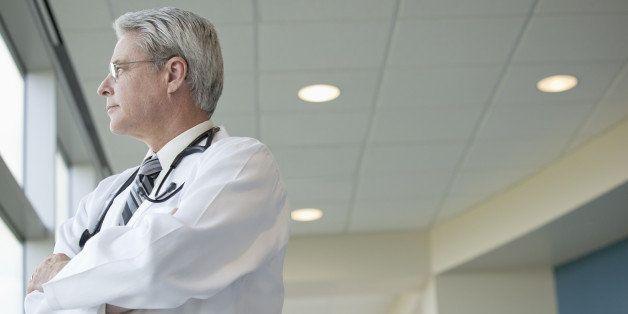Caucasian doctor standing in hospital