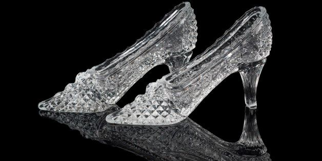 Pair of woman crystal shoes on the black background
