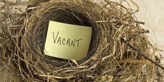 empty nest with a sign that says, Vacant