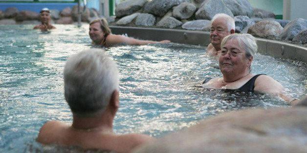 RUESSELSHEIM, GERMANY - SEPTEMBER 03:  Elderly people rest in a public swimming pool on September 3, 2005 in Ruesselsheim, Ge