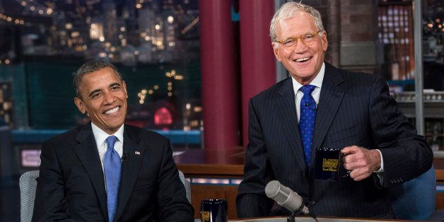 US President Barack Obama and David Letterman speak during a break in the taping of the 'Late Show with David Letterman' at t