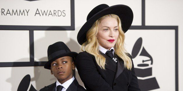 Madonna and her eight-year-old son David Banda pose on the red carpet for the 56th Grammy Awards at the Staples Center in Los