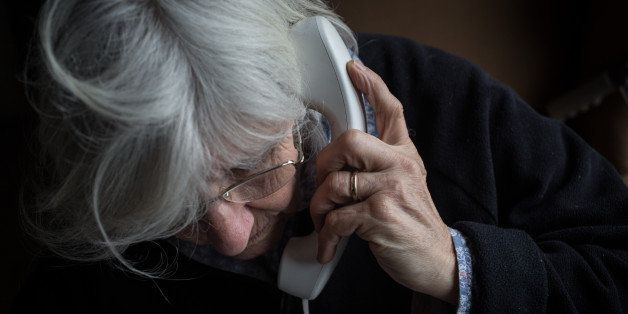 BRISTOL, ENGLAND - FEBRUARY 16:  In this photo illustration an elderly person uses a telephone on February 16, 2015 near Bris