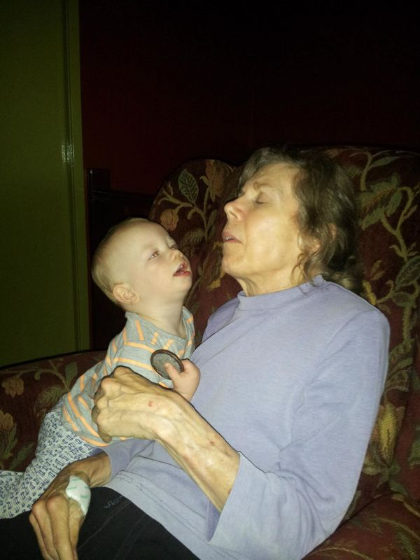<strong>Cuddles with her 14-month-old grandson. He's very careful with her, knows she's special. </strong>
