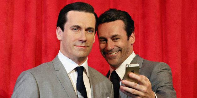 NEW YORK, NY - MAY 09:  Actor Jon Hamm takes a selfie as he unveils Don Draper's wax figure during Mad Men's Final Season at