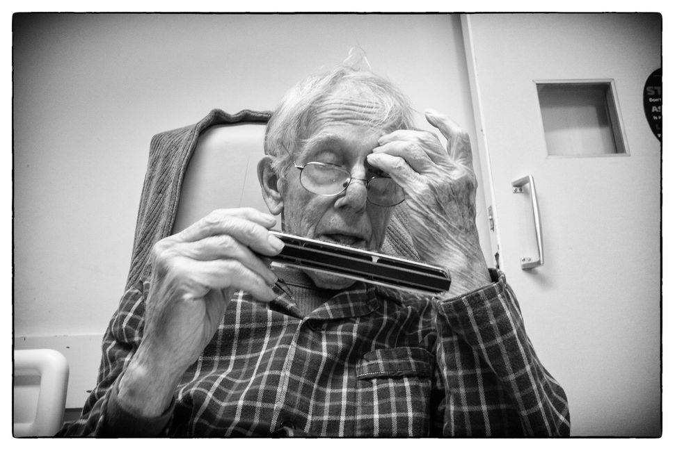 May 2014 Ronnie plays his harmonica at Oak House, an assisted living facility where he lived until he died in March 2015.