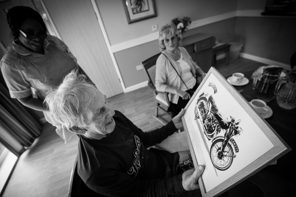 Ronnie is shown aa photo of his beloved Vincent Black Shadow motorcycle and despite not knowing the names of his family membe