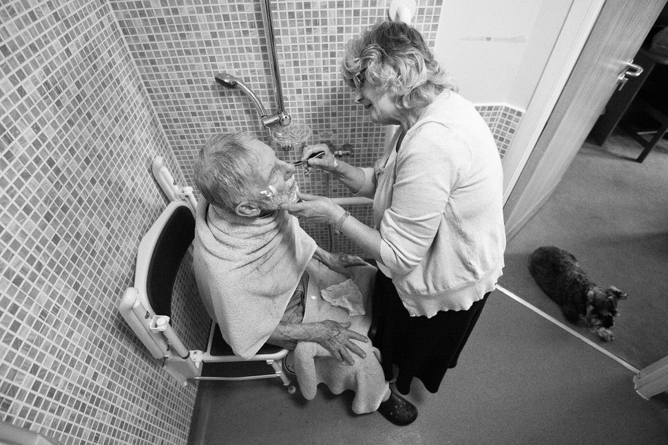 Winnie helps Ronnie shave in July 2014.