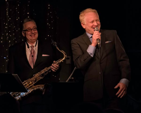 Don Most sings with saxophone player Willie Scoppettone.