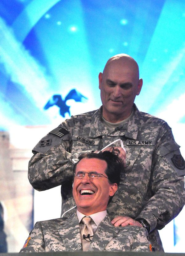 Gen. Ray Odierno, Commanding General, Multinational-Force-Iraq, pretends to give actor/comedian Stephen Colbert of Comedy Cen