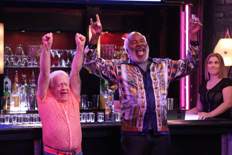 "Sid (Leslie Jordan) celebrates with Hank (David Alan Grier) in ""The Cool Kids,"" airing Fridays on Fox."