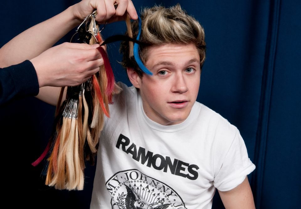 One Direction singer Niall Horan jokes with experts from Madame Tussauds waxworks museum regarding his hair color in this Jan