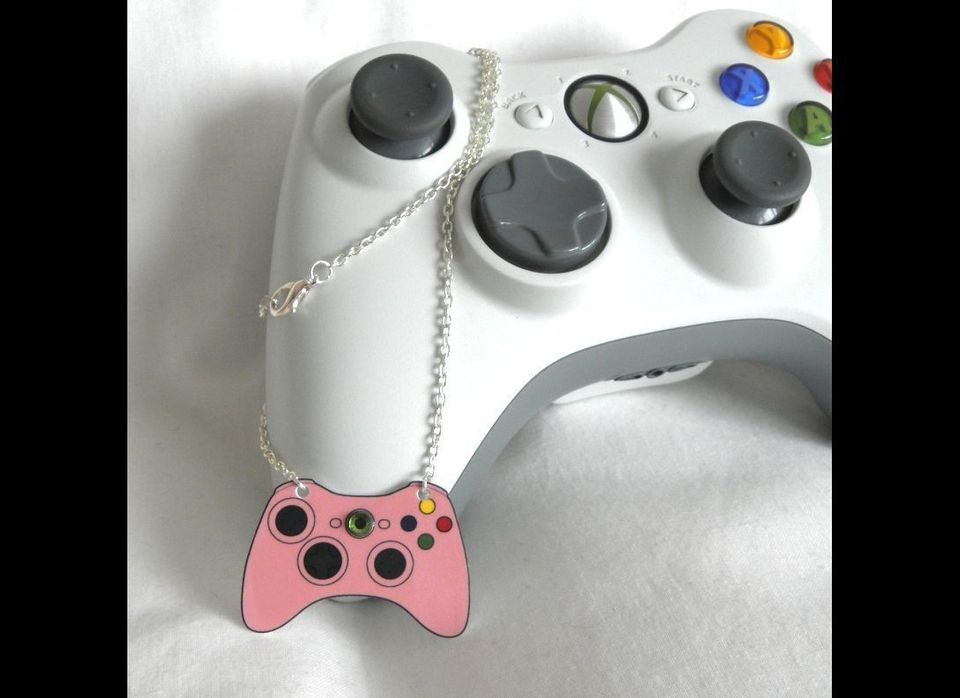 """Get pretty in pink with this <a href=""""http://www.craftisart.com/85931/girl-gamer-pink-xbox-360-video-games-controller-necklac"""