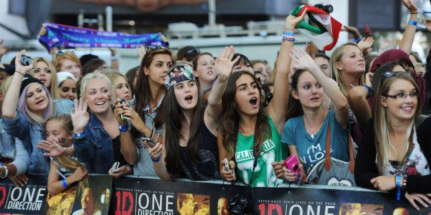 LONDON, ENGLAND - AUGUST 20:  Fans attend the world premiere of 'One Direction - This Is Us' at The Empire Leicester Square o