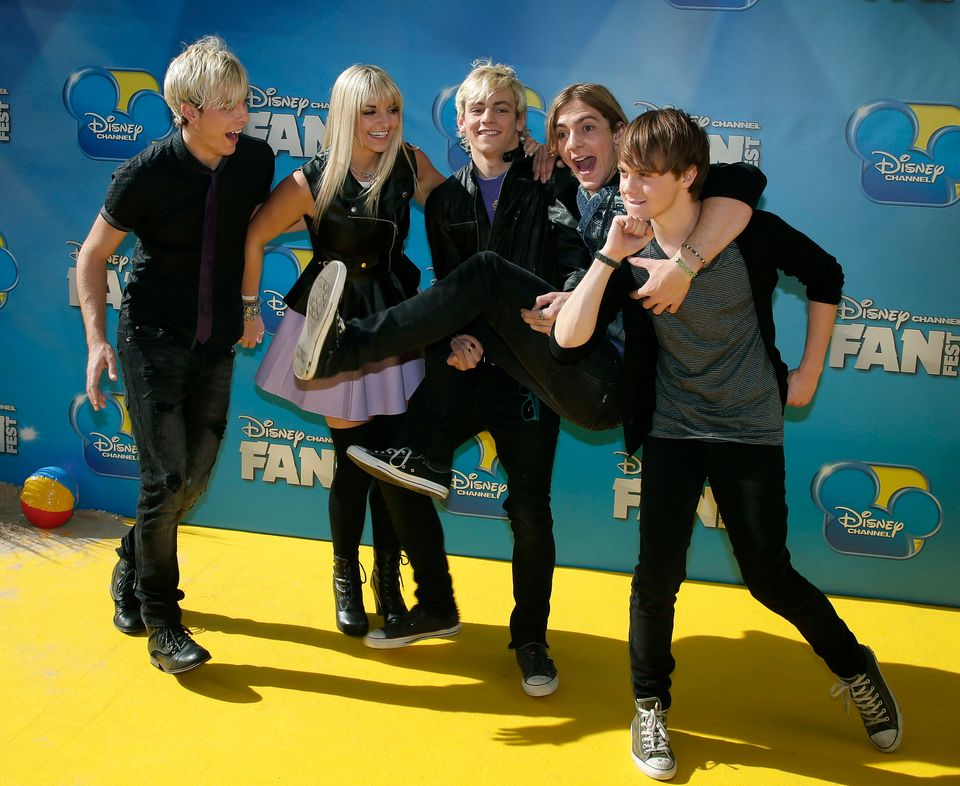 The teen band R5 including Ross Lynch,, center poses for a photo while walking on the red carpet for the premiere of the Disn