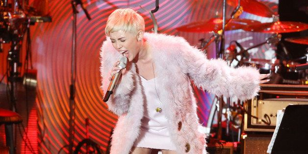 BEVERLY HILLS, CA - JANUARY 25:  Miley Cyrus performs onstage during the Clive Davis and The Recording Academy present The An