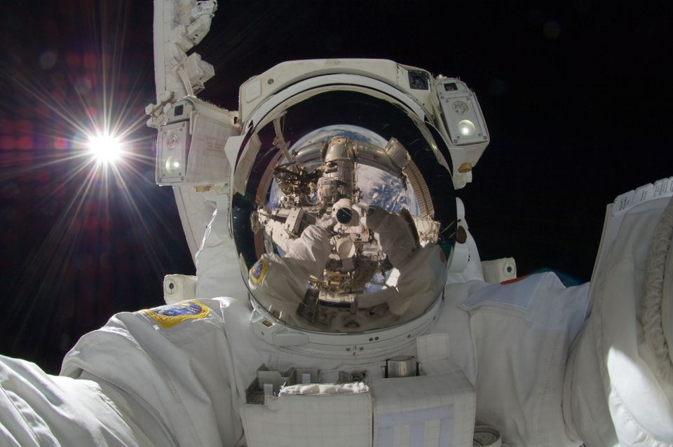 Japanese astronaut Aki Hoshide earned a spot in the Selfie Hall of Fame with a striking, other-worldly shot, arms extended as