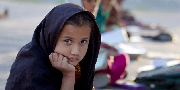 Pakistani student Farah Muneeb from Islamabad's slums sits with fellow students at a makeshift school set up by a volunteer i