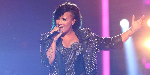 Demi Lovato performs at the Vevo Certified SuperFanFest Live Concert at the Barker Hangar on Wednesday, Oct. 8, 2014, in Sant