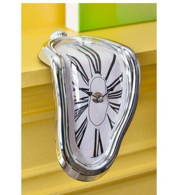 "<em><a href=""http://www.modcloth.com/shop/clocks-gadgets/in-surreal-time-clock"" target=""_hplink"">Modcloth,</a> $19.99</em>  <"