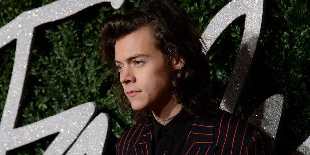 Harry Styles poses for photographers upon arrival at The British Fashion Awards 2014, in London, Monday, Dec. 1, 2014. (Photo