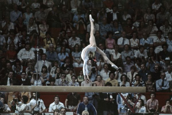 "The Romanian gymnast won three gold medals at the 1976 Games. She was the first female gymnast to be awarded a <a href=""http:"