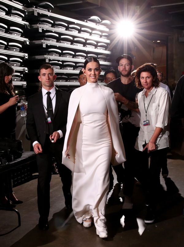 "Looking regal in white. Also, channeling her inner <a href=""http://www.huffingtonpost.ca/2014/11/17/solange-knowles-wedding-d"