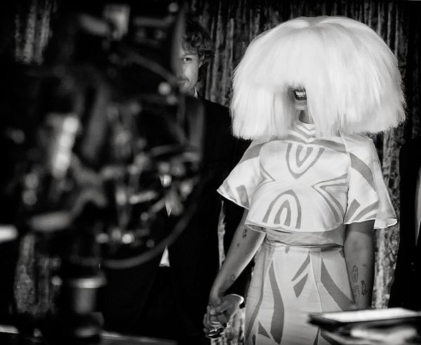 Even underneath all that hair, we can see Sia's beaming smile.