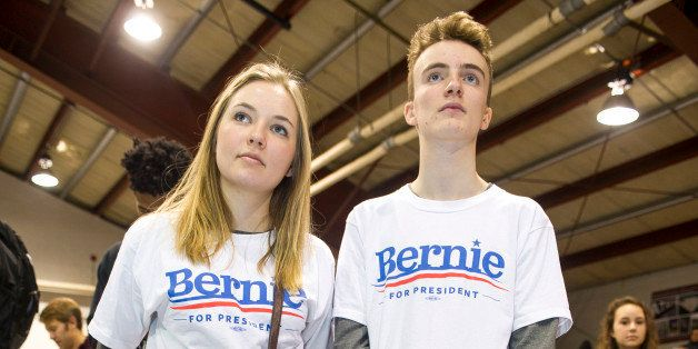 RINDGE, NH - FEBRUARY 6: Noah Pruzan-Jorgensen and Ida Schou, volunteers from Denmark, listen to Bernie Sanders speak at a Ge
