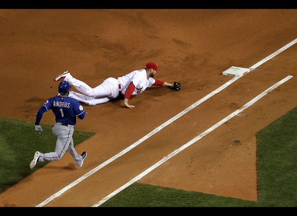 Chris Carpenter #29 of the St. Louis Cardinals tags first base for an out to beat Elvis Andrus #1 of the Texas Rangers during