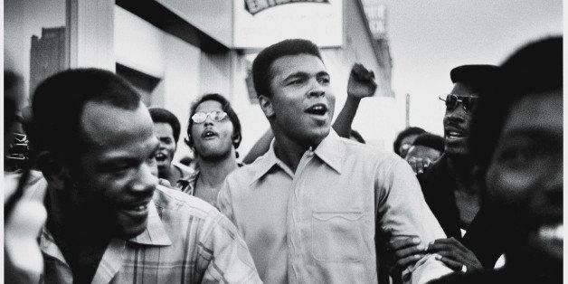 American heavyweight boxing champion Muhammad Ali walks through the streets with members of the Black Panther Party, New York