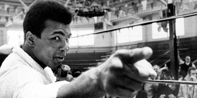 Heavyweight boxer Muhammad Ali makes a point during a news conference that he conducts from inside the ring in Atlanta, Ga.,