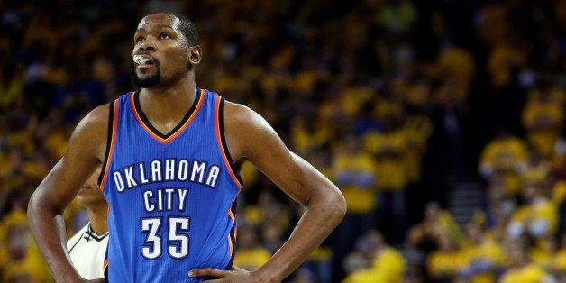 FILE - In this May 26, 2016, file photo, Oklahoma City Thunder's Kevin Durant watches during the closing minutes of the secon