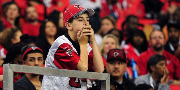 ATLANTA, GA - NOVEMBER 10: A young fan of the Atlanta Falcons watches the action against the Seattle Seahawks at the Georgia