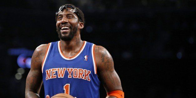 FILE - In this Dec. 5, 2013, file photo, New York Knicks forward Amare Stoudemire smiles before shooting a free throw during