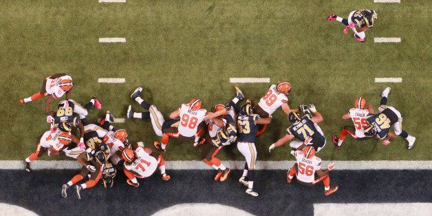 The St. Louis Rams offensive line and tight ends block for running back Todd Gurley, top right, who scored untouched around l
