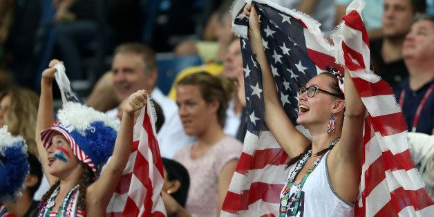 RIO DE JANEIRO, BRAZIL - AUGUST 06:  Fans hold up United States flags during the Men's Preliminary Round Group A match betwee