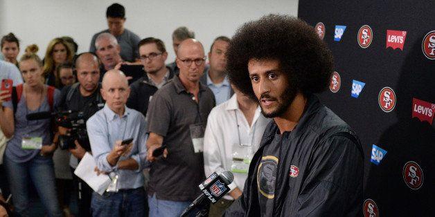 Sep 1, 2016; San Diego, CA, USA;  San Francisco 49ers quarterback Colin Kaepernick (right) talks to media after the game agai