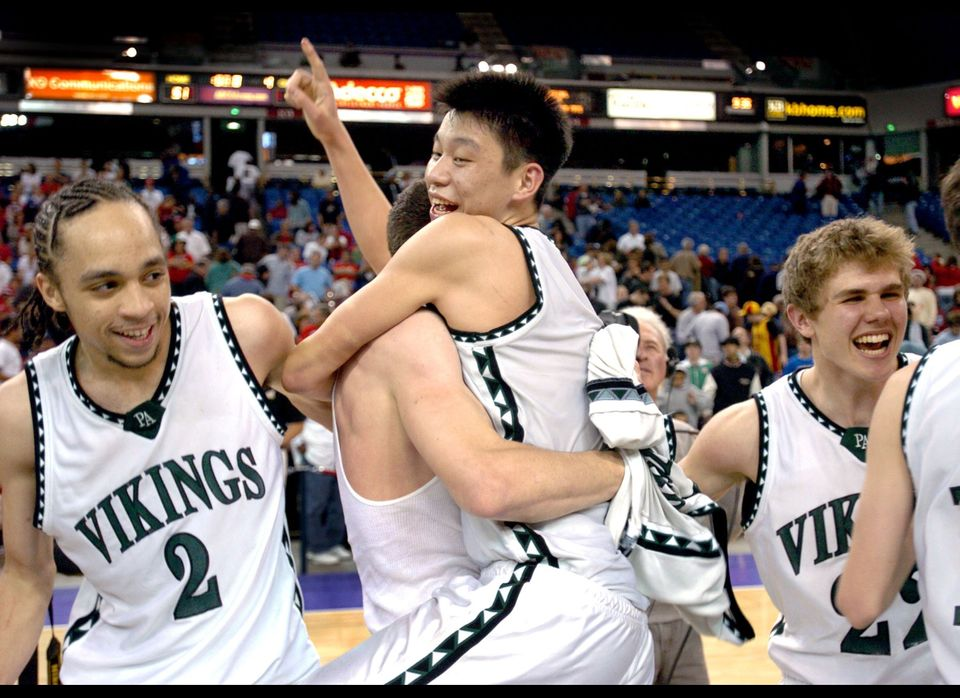 Palo Alto guard Jeremy Lin, center, celebrates with teammates Steven Brown, left, Cooper Miller, and Brian Karvaries, right,