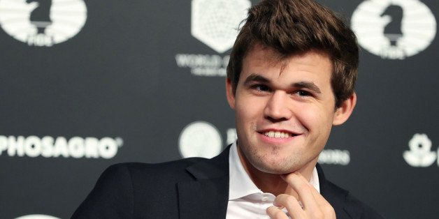 World Chess Champion Magnus Carlsen of Norway, smiles after defeating Sergey Karjakin (not shown) of Russia at the 2016 World