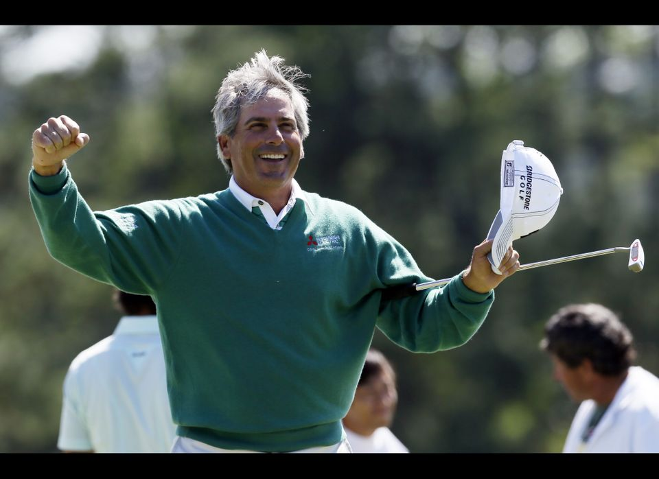 Fred Couples celebrates after finishing the second round the Masters golf tournament on the 18th hole Friday, April 6, 2012,