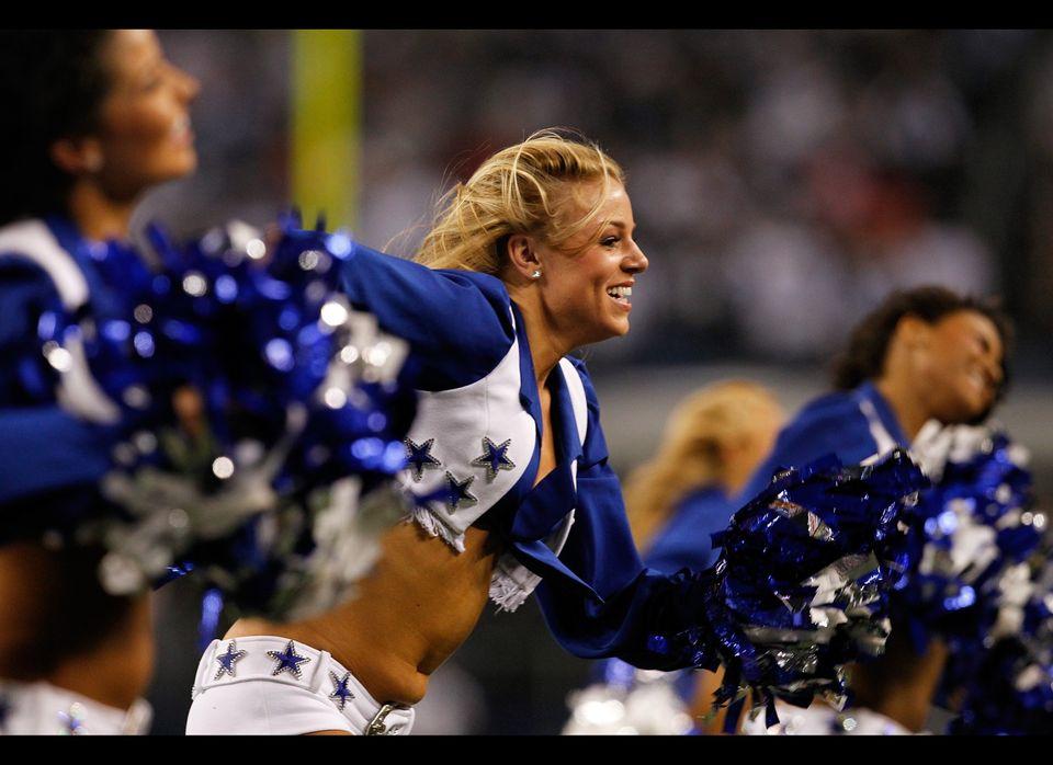The Dallas Cowboys cheerleaders perform at Cowboys Stadium on December 11, 2011 in Arlington, Texas.