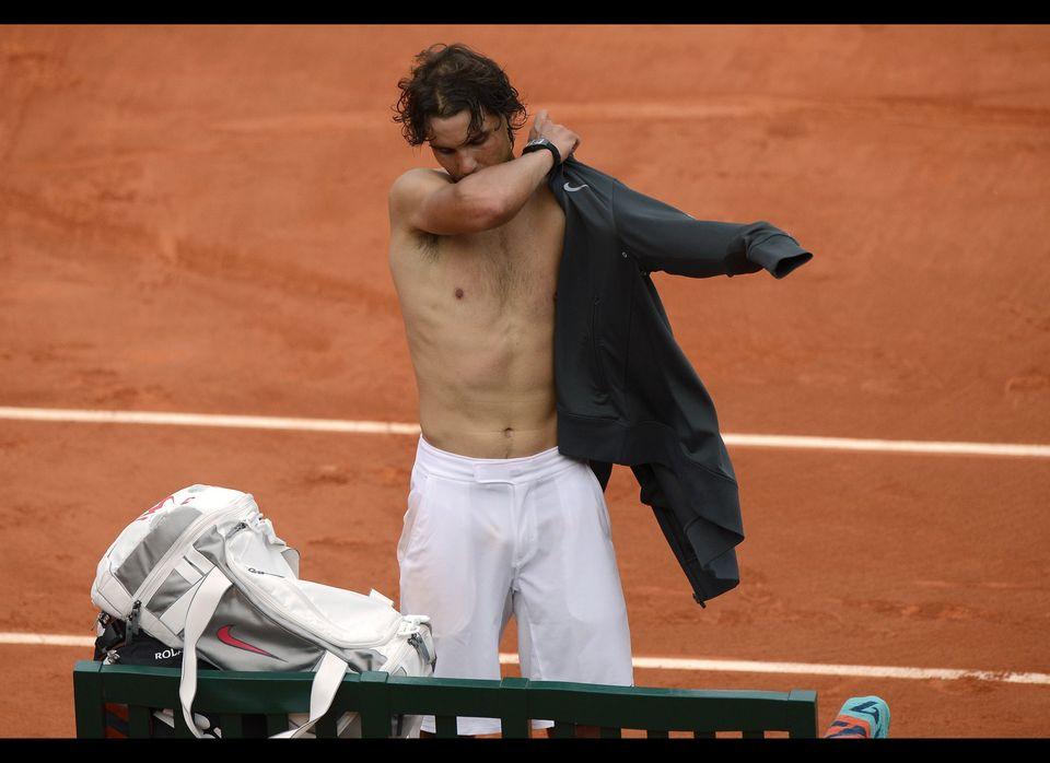 Spain's Rafael Nadal puts his jacket after winning over Argentina's Eduardo Schwank during their Men's Singles 3rd Round tenn
