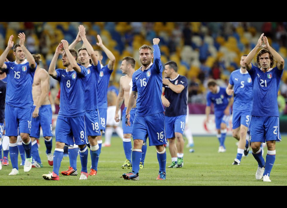 Italian players celebrate after winning the penalty shootout during the Euro 2012 soccer championship quarterfinal match betw