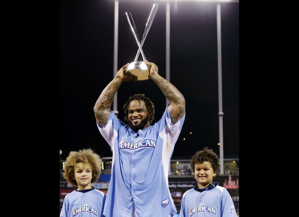 American League's Prince Fielder, of the Detroit Tigers, poses with his children Jaden, left, and Haven after receiving the M