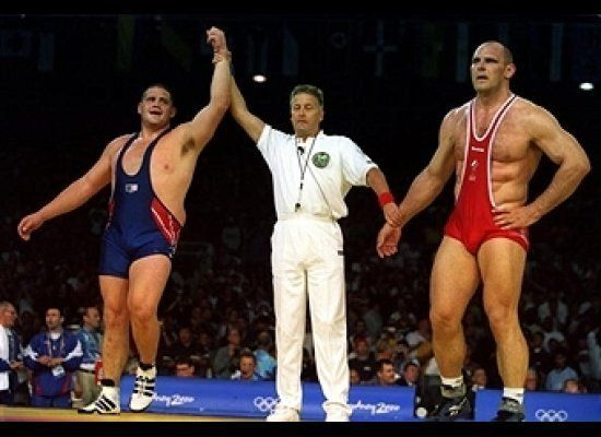 American Rulon Gardner pulled off a stunning upset, defeating Russian wrestling icon Alexander Karelin to win the Olympic sup